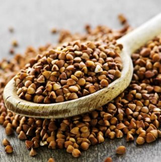 dried-buckwheat-grains-on-a-wooden-spoon
